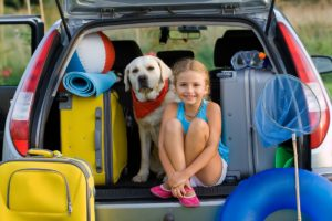 Dog and a girl inside a car