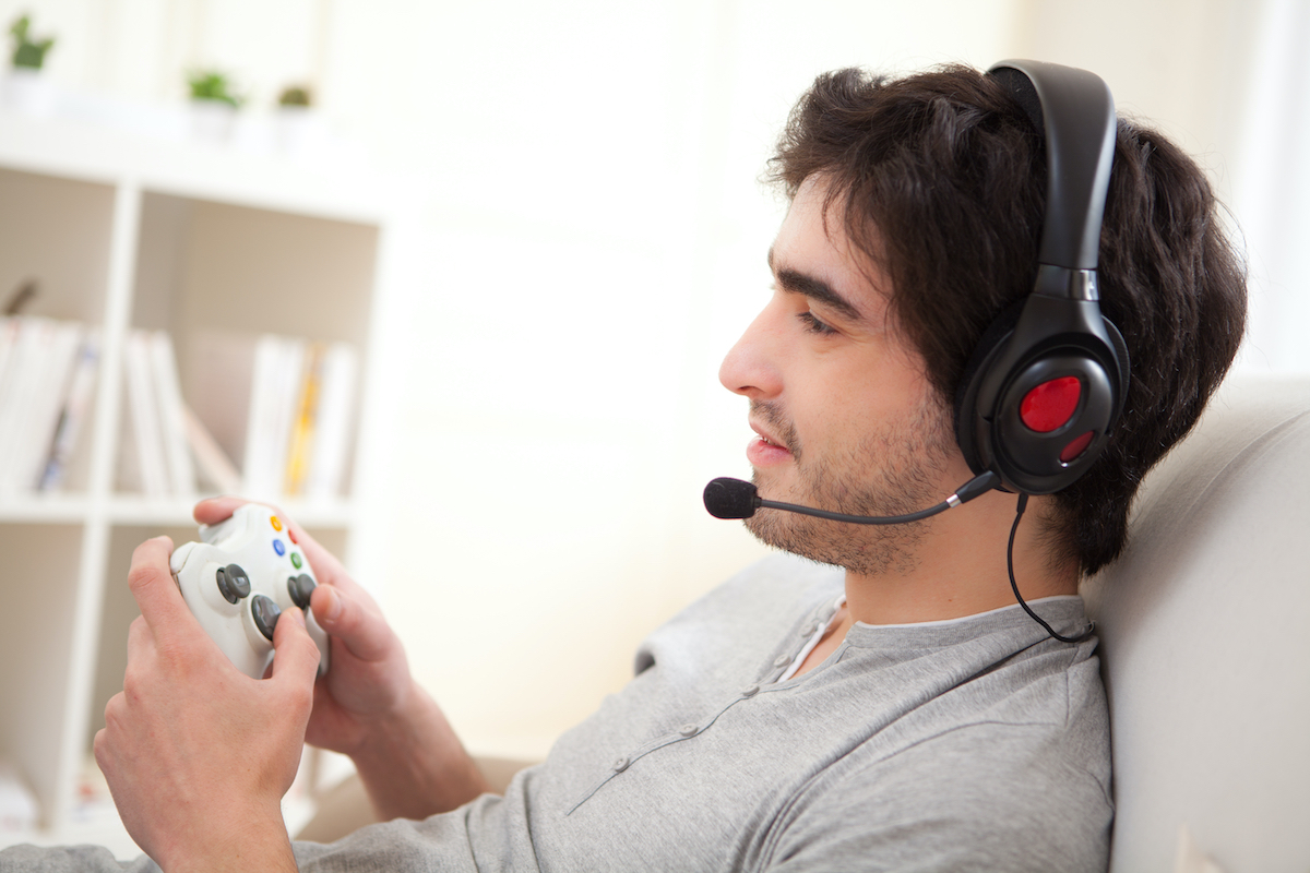 man playing xbox