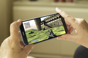person playing mobile games