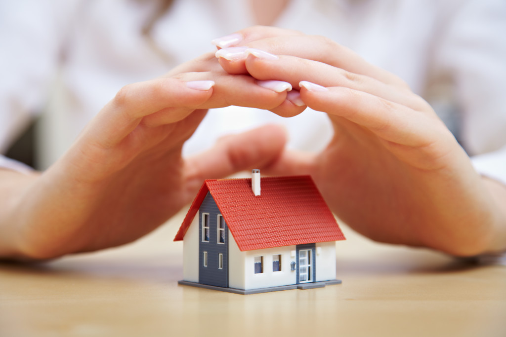 hands over house model