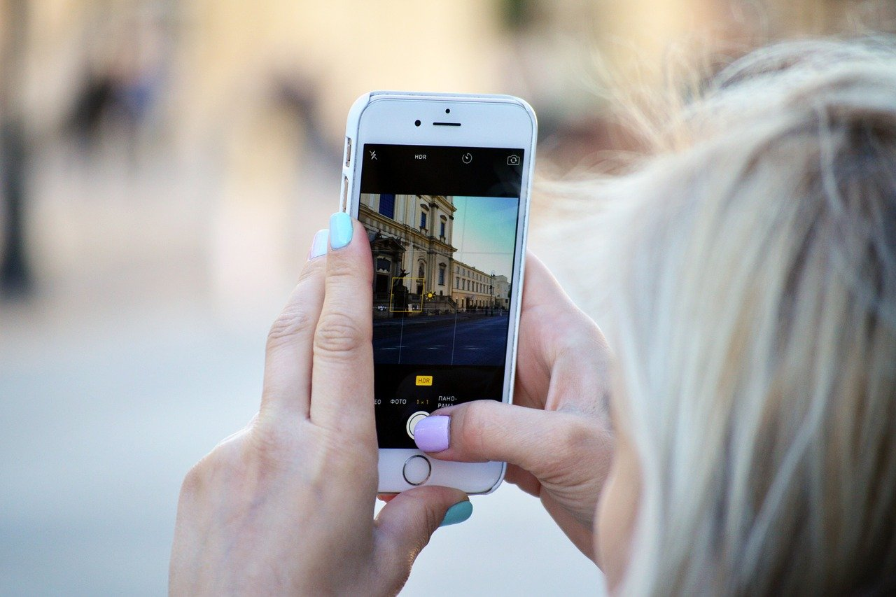 person-taking-pictures-using-a-phone