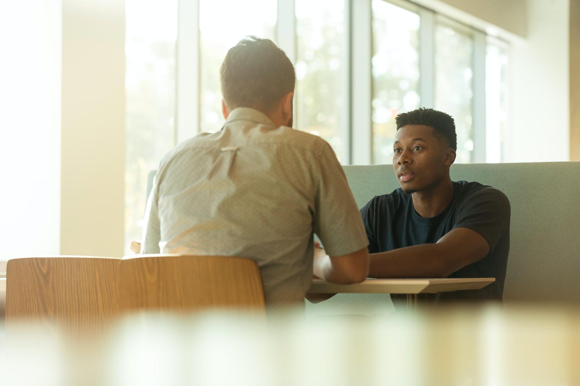 men-talking-in-a-lounge