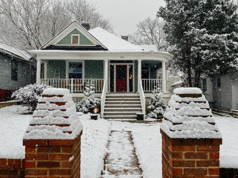 a home covered in snow