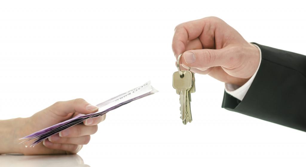 handing over keys to buyer