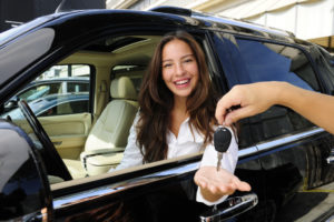 businesswoman with new car
